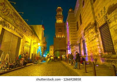 CAIRO, EGYPT - DECEMBER 20, 2017: After dusk Al-Muizz street wakings up, the building's illumination switches on and the groups of youth come, on December 20 in Cairo.