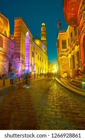 CAIRO, EGYPT - DECEMBER 20, 2017: The view on great medieval edifices on Al-Muizz street in bright night illumination, on December 20 in Cairo.