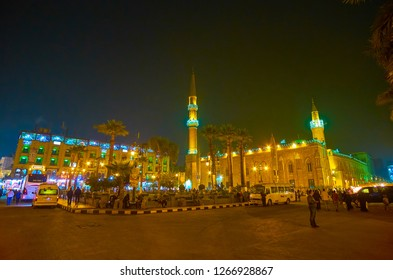 CAIRO, EGYPT - DECEMBER 20, 2017: Midan Hussein Square with illuminated Al-Hussein Mosque and neighbor edifices and spontaneous market are very crowded after dusk, on December 20 in Cairo.