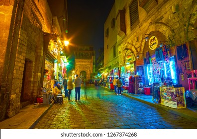 CAIRO, EGYPT - DECEMBER 20, 2017: The late evening is the best time to walk in old Cairo, the comfortable temperature and already open cafes and restaurants promote to this, on December 20 in Cairo.