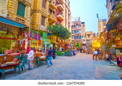 CAIRO, EGYPT - DECEMBER 20, 2017: The wide street with traditional Egyptian restaurants in Khan EL-Khalili Souq that alternate with souvenir and clothes shops, on December 20 in Cairo.