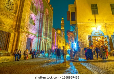CAIRO, EGYPT - DECEMBER 20, 2017: The beautiful illuminated edifices in Al-muizz street attract people to spend a time here and enjoy magnificent medieval architecture, on December 20 in Ca