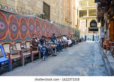 Cairo / Egypt - December, 2015: Men smoking hookah on the street