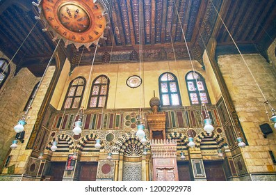 CAIRO, EGYPT - DECEMBER 21, 2017: Stunning interior of Al-Ghuri Mosque-Madrasa, its scenic mihrab is covered with stone inlay and the minbar created of carved wood with ivory, on December 21 in Cairo.