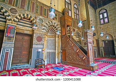 CAIRO, EGYPT - DECEMBER 21, 2017:  Mihrab (niche) and minbar (pulpit) of Al-Ghuri Mosque-Madrasa with complex Islamic patterns of carved wood, stone and ivory, on December 21 in Cairo