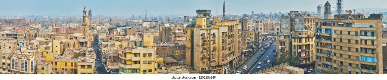 CAIRO, EGYPT - DECEMBER 21, 2017: The old quarters of Islamic Cairo with medieval minarets, dominating the skyline, on December 21 in Cairo.