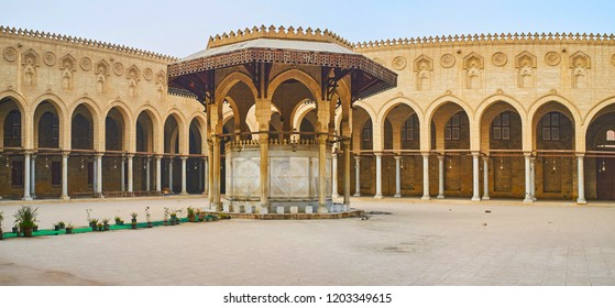 CAIRO, EGYPT - DECEMBER 21, 2017:  The ornate ablution fountain of Sultan Al-Muayyad mosque with carved wooden roof, slender pillars and stone arches, on December 21 in Cairo.
