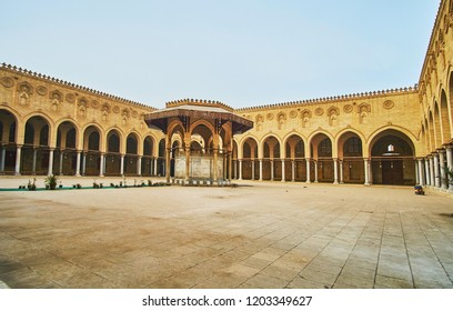 CAIRO, EGYPT - DECEMBER 21, 2017:  The large courtyard of Sultan Al-Muayyad mosque with ablution fountain in the middle and arcades on each side, on December 21 in Cairo.