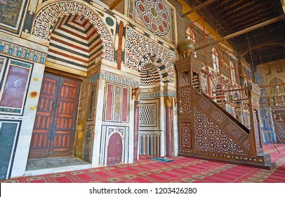 CAIRO, EGYPT - DECEMBER 21, 2017:  Intricate stone decors of Al-Muayyad mosque, its mihrab boasts fine Islamic patterns with stone inlay, minbar made of carved wood with ivory, on December 21 in Cairo