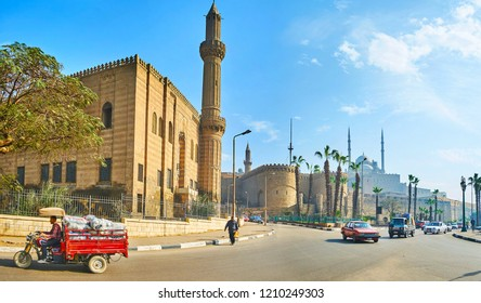 CAIRO, EGYPT - DECEMBER 21, 2017: The view on Saladin citadel from the Salah El-Deen square, the place with fast traffic and numerous historic landmarks, on December 21 in Cairo.
