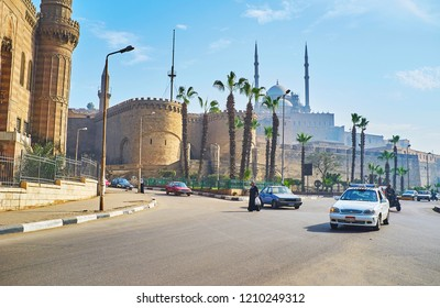 CAIRO, EGYPT - DECEMBER 21, 2017: The traffic on busy Salah El-Deen square with a view on medieval Saladin Citadel and Muhammad Ali mosque - iconic landmark of Islamic Cairo, on December 21 in Cairo.