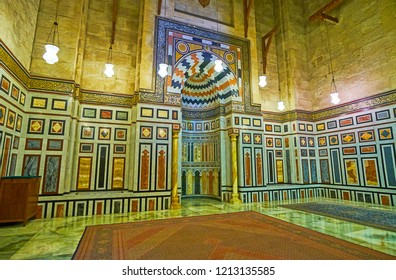 CAIRO, EGYPT - DECEMBER 21, 2017: The walls and mihrab in chamber of Iranian Shah's Mausoleum are decorated with colorful stone tiles, Al-Rifai (Royal) Mosque, on December 21 in Cairo.