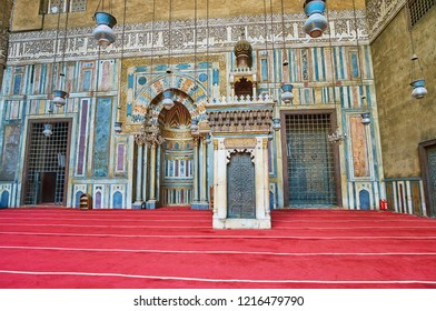 CAIRO, EGYPT - DECEMBER 21, 2017: The rich stone decors of Sultan Hassan Mosque-Madrasa, the mihrab and minbar are covered with intricate patterns of carved stone and wood, on December 21 in Cairo
