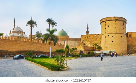 CAIRO, EGYPT - DECEMBER 21, 2017: The tall medieval wall of Saladin Citadel with preserved watchtower hides the old mosques of Muhammad Ali and Al-Nasir Muhammad, on December 21 in Cairo