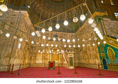 CAIRO, EGYPT - DECEMBER 21, 2017: The mihrab and minbar of Alabaster (Muhammad Ali) Mosque in Saladin Citadel behind the bright oil (mosque) lamps, on December 21 in Cairo