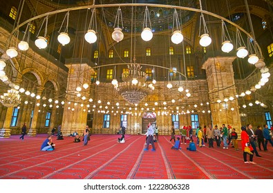 CAIRO, EGYPT - DECEMBER 21, 2017: The tourist groups enjoy interior of historic Muhammad Ali (Alabaster) Mosque of Saladin Citadel, famous for its beauty, on December 21 in Cairo