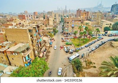 CAIRO, EGYPT - DECEMBER 22, 2017: The view from minaret of Amir Sarghatmish madrasa on Al Khoderi street, mosques of Islamic Cairo and Saladin Citadel on background, on December 22 in Cairo, Egypt.