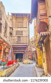 CAIRO, EGYPT - DECEMBER 23, 2017: The old ramshackle edifice in El-Gamaleya street with outdoor cafe next to it, on December 23 in Cairo
