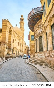 CAIRO, EGYPT - DECEMBER 23, 2017: The El-Muizz street is the main tourist street in Islamic Cairo with main landmarks on it, on December 23 in Cairo