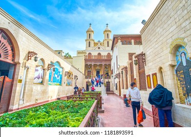 CAIRO, EGYPT - DECEMBER 23, 2017:  The courtyard of the Hanging Church with flower beds and mosaic icons on the walls, on December 23 in Cairo