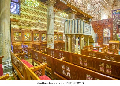 CAIRO, EGYPT - DECEMBER 23, 2017: The medieval St Barbara Church boasts Byzantine style ancient icons and stone carved pulpit in prayer hall, on December 23 in Cairo.