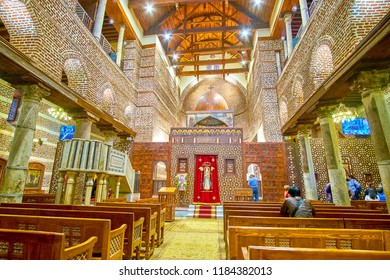 CAIRO, EGYPT - DECEMBER 23, 2017: The beautiful interior of St Barabara Church with high carved sanctuary  screeen, on December 23 in Cairo.
