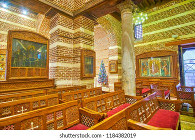CAIRO, EGYPT - DECEMBER 23, 2017: The prayer hall of St Barbara Church decorated with ancient icons in byzantine style, on December 23 in Cairo.