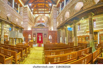 CAIRO, EGYPT - DECEMBER 23, 2017: The interior of beautiful medieval St Barbara Church with frescoes on Nave's columns, on December 23 in Cairo.