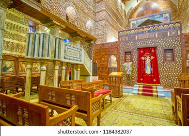 CAIRO, EGYPT - DECEMBER 23, 2017: The beautiful sanctuary screen decorated with geometrical carved patterns with two royal doors on the sides, on December 23 in Cairo.
