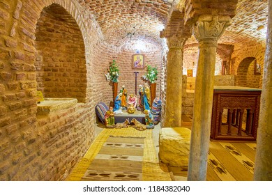 CAIRO, EGYPT - DECEMBER 23, 2017: The underground crypt with ancient columns located in St Barbara Church, on December 23 in Cairo.