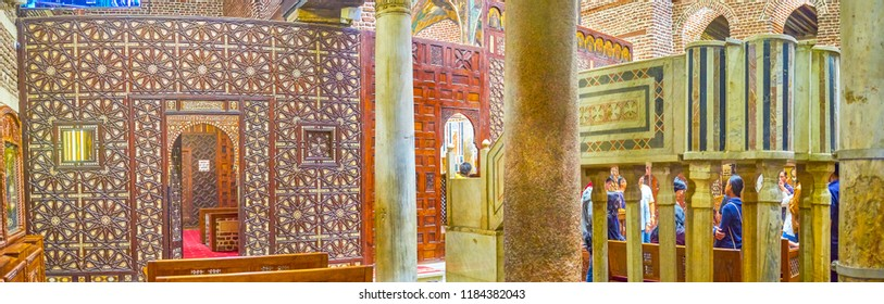 CAIRO, EGYPT - DECEMBER 23, 2017: The beautiful sanctuary screen with carved geometric inlay of ivory is one of the most beautiful element of the St Barbara interior, on December 23 in Cairo.