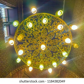 CAIRO, EGYPT - DECEMBER 23, 2017: The beautiful metal chandelier decorated with carved crosses in the aisle of St Barbara Church, on December 23 in Cairo.