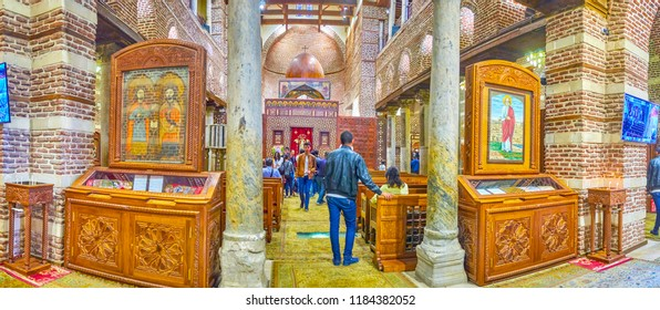 CAIRO, EGYPT - DECEMBER 23, 2017: The panoramic view on the prayer hall of medieval St Barbara Church, decorated with medieval icons in wooden kiots, on December 23 in Cairo.