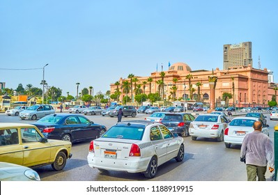 CAIRO, EGYPT - DECEMBER 23, 2017: The rush time in Midan Tahrir square with beautiful Egyptian Museum building on the background, on December 23 in Cairo