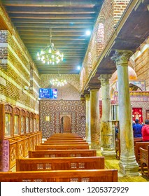 CAIRO, EGYPT - DECEMBER 23, 2017: The side aisle of St Barbara Church with rows of seats and carved sanctuary screen on the backbround, on December 23 in Cairo.