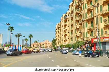 CAIRO, EGYPT - DECEMBER 24, 2017:  Midan Al Tahrir (Martyrs Square) is always busy and crowded, here locate administrative buildings, luxury hotels, Egyptian Museum and stores, on December 24 in Cairo