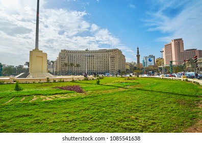 CAIRO, EGYPT - DECEMBER 24, 2017: Panoramic view of Midan Al Tahrir square with green lawn in the middle and administrative buildings on background, on December 24 in Cairo