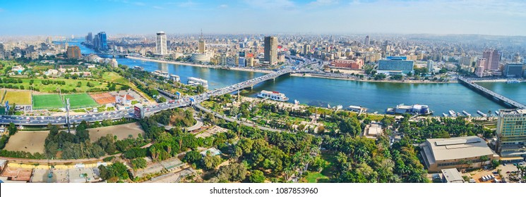 CAIRO, EGYPT - DECEMBER 24, 2017: Aerial view of Gezira Island with wide green areas - gardens or park and Downtown district with dense housing and bridges across Nile river, on December 24 in Cairo