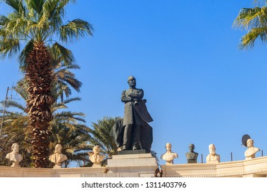 Cairo, Egypt - December 8, 2018: Monument to founder of Museum of Egyptian Antiquities Auguste Mariette in Garden of the Egyptian Museum on Tahrir Square in Cairo, Egypt