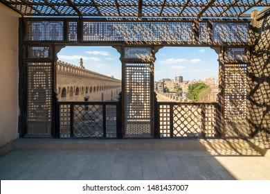 Cairo, Egypt- February 18 2017: Passage surrounding the Mosque of Ibn Tulun framed by interleaved wooden perforated wall, Mashrabiya, Medieval Cairo