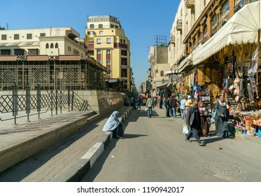 Cairo, Egypt February 20, 2017: Street in the market called Khan El Khalili, the most famous street in the city with Arabs walking and shopping in street stalls