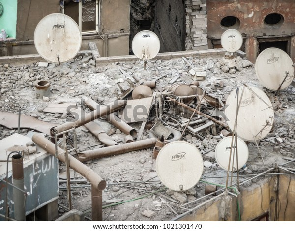 Cairo, Egypt - February 2015: satellite dish on a devastated roof in Cairo old town. Most of slum housing in Cairo bristling with satellite dishes despite the poverty.