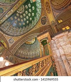Cairo, Egypt - February 24, 2010: Gold Minbar in Muhammad Ali Pasha Mosque at Citadel in Cairo, Egypt.