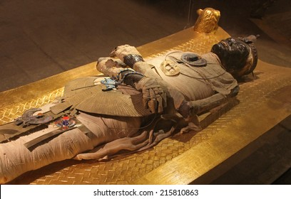 CAIRO, EGYPT - FEBRUARY 26; Ancient mummy in Egyptian village tourist attraction near Cairo, Egypt - February 26, 2010; Mummy style body show cased as tourist attraction among other old artifacts.