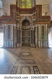 Cairo, Egypt - February 3, 2018: Mausoleum of Sultan Qalawun with decorated colorful marble niche (Mihrab) embedded in ornate marble wall, and colorful stain glass windows, Moez Street