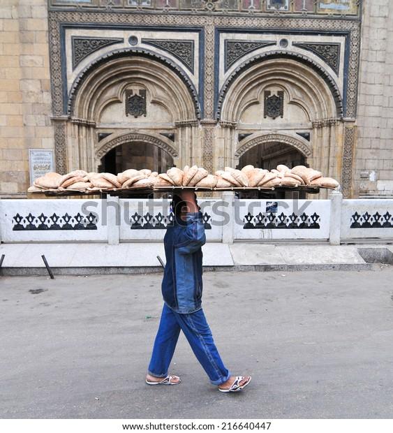 CAIRO, EGYPT - JANUARY 1, 2009 - Bread Delivery Man through the Citadel Cairo, Egypt.
