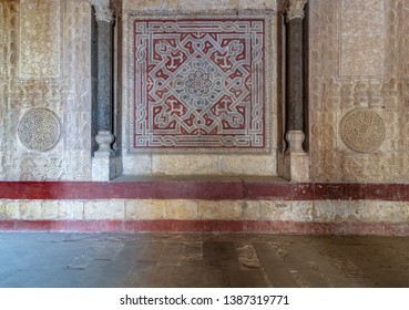 Cairo, Egypt- January 1 2019: Stone wall decorated with colorful engraved floral and geometric patterns at the entrance of Sultan Hassan public historical mosque, Old Cairo