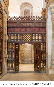 Cairo, Egypt- January 14 2017: Interleaved wooden wall (mashrabiya) with wooden ornate door in Sultan Qalawun mosque, a historic mosque in Old Cairo