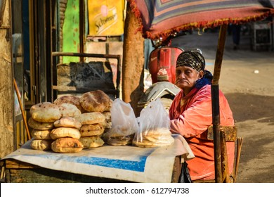 CAIRO, EGYPT - JANUARY 23, 2016: An old woman sells local bread at historical Khan El-Khalili Souq marketplace is one of the tourist magnets in Capital City Cairo
