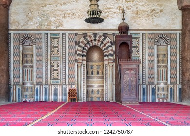 Cairo, Egypt - January 3 2018:  Colorful decorated marble wall with engraved Mihrab (niche) and wooden Minbar (Platform) at the Mosque of Al Nasir Mohammad Ibn Qalawun, Citadel of Cairo